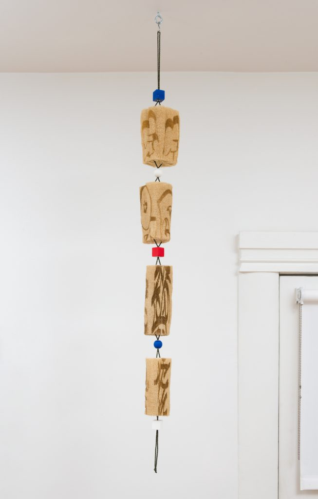 Spencer Longo, LEXI (Redux 3), 2014/2017. Loofah, nylon cord, wood beads, enamel paint and hardware. 52 x 4.5 x 4.5 inches. Photo: Jeff McLane.