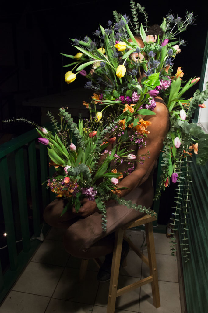 Genevieve Belleveau, Transactional Aesthetics, 2018. Performed with Themba Alleyne. Durational performance with spoken word, harness, and tulips. Courtesy the artist and Garden, Los Angeles.